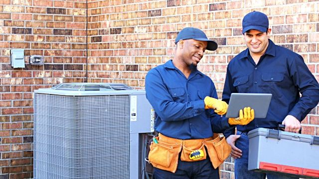 air conditioning repair men working